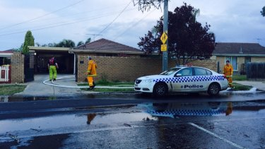 Firefighters drain the pool at  a Melton South house where a two-year-old drowned on Monday.