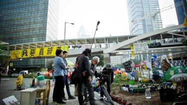 Christopher Doyle, Australian cinematographer and filmmaker, filming in Hong Kong.