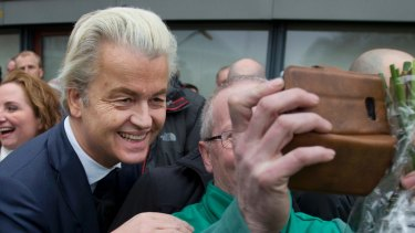 Dutch Anti-Islam lawmaker Geert Wilders poses for a picture during an election campaign stop in Spijkenisse, near Rotterdam, Netherlands.