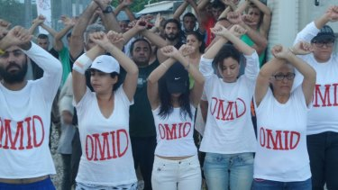 Refugees at Nauru wear t-shirts with Omid Masoumali's name as a show of solidarity.