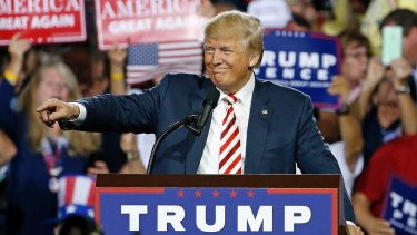 Republican presidential candidate Donald Trump points to supporters as he speaks at a campaign rally  in Arizona on Tuesday.