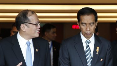 Philippine's President Benigno Aquino III, front left, and Indonesia's President Joko Widodo, front right, chat after the plenary session of the 26th ASEAN Summit in Kuala Lumpur, Malaysia, on Monday, April 27, 2015. (AP Photo/Joshua Paul)