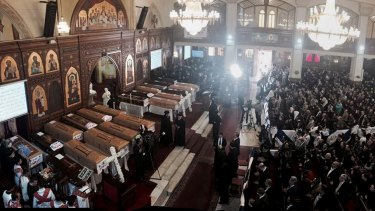 Coffins are laid out during a service for victims of the December cathedral bombing in Cairo.