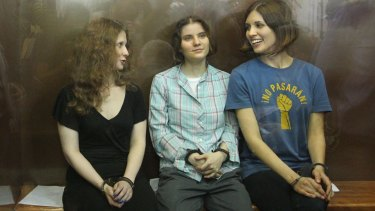 Maria Alyokhina, left, with fellow Pussy Riot members Yekaterina Samutsevich and Nadezhda Tolokonnikova after their sentencing in Moscow in 2012.