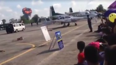 A still from a video posted on the Hatyai Social.com Facebook page shows the explosion from a jet crash at Hat Yai Airport in Thailand.