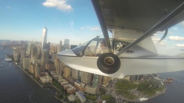 Michael Smith flies into New York during his solo journey around the world in an amphibious flying boat. The journey  is the focus of Rob Murphy's documentary Voyage of the Southern Sun.
