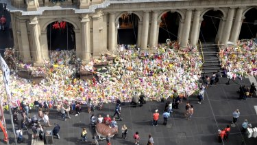 Tributes grow on the steps of the GPO building in Melbourne's Bourke Street.