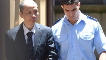 Robert Xie leaves court after the jury was discharged.