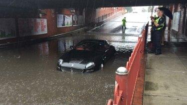 A Maserati stricken in floodwater on Victoria Street, Seddon on Saturday.