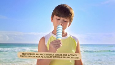 """A still image from the video that displayed the message: """"True heroes balance energy intake and activity enjoy Paddle Pop as a treat within a balanced diet."""""""
