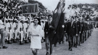 Johnny Warren carries the flag at the opening ceremony of the Friendship Tournament in Saigon, 1967.