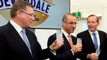 Former Murray Goulburn managing director Gary Helou (centre) in happier times with former prime minister Tony Abbott (right) and former Victorian premier Denis Napthine.
