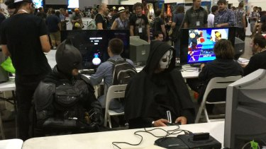 Batman takes a break from his busy schedule to get reacquainted with the Sega Mega Drive II game console at PAX.