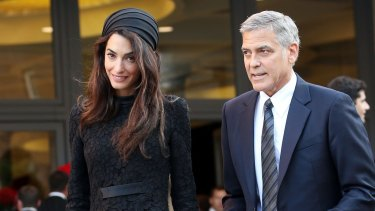 Amal Clooney and her husband George leave their meeting with the Pope in Vatican City last week.