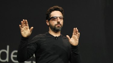 """Google's co-founder Sergey Brin joined hundreds protesting at San Francisco airport. """"I'm here because I'm a refugee,"""" he told a reporter."""