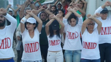 Refugees on Nauru wear T-shirts with Omid's name as a show of solidarity.