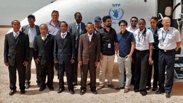(Front row, from left) The four Thai fishermen after their release, before boarding a UN flight in Galkayo.