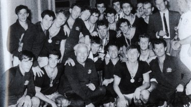 Battle-weary heroes: The victorious Socceroos (including Johnny Warren, front row, second from left) after winning the Friendship tournament in Saigon, Vietnam, in 1967.
