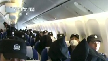 With black hoods hiding their faces, the Uighurs were deported from Thailand to China.