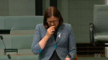 Liberal MP Sarah Henderson breaks down in Parliament.