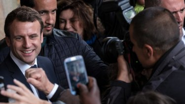 Macron meets with supporters during an election campaign event in Rodez on Friday.