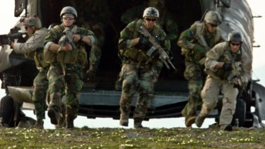 Members of a Navy SEAL team participate in infiltration and exfiltration training at Fort Wainwright, Alaska.