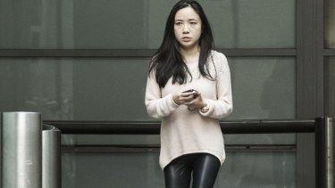Yingying Dou leaves the Sydney premises where she works on Monday.