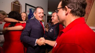 Chief Minister-elect Michael Gunner meets the party faithful at Waratahs football club in Darwin on victory night.