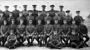 Alec Campbell, second from right seated on the ground, aged 16 years old, just after he enlisted.