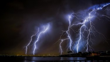 Boom, flash ... A view of the skyline from Brighton Pier, taken at the height of last night's storm.