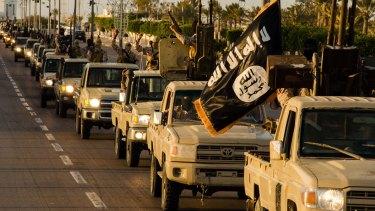 Executing Christians ... Members of the Islamic State (IS) jihadist group parade down a street in Libya's coastal city of Sirte.