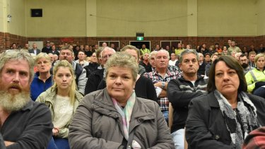 Griffin Coal employees and their families express their fears at a recent community meeting over the pay cuts.