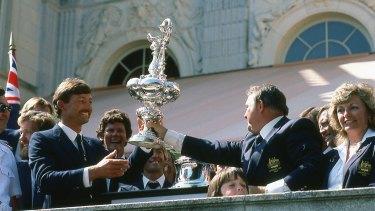 Alan Bond and John Bertram hoist the cup. Lesleigh Green, right.