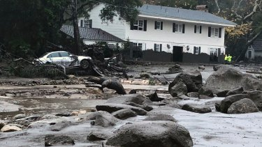 The mudslides swept Southern California homes from their foundations as a powerful storm drenched recent wildfire burn areas.