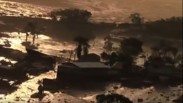 Television images showed a torrent of thick red mud several hundred metres long that had swamped houses as it surged down valleys in the hilly region.