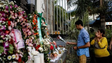 A man places flowers at the Bali Bombing Memorial Monument in Kuta, Bali, Indonesia in 2013.