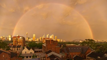 A full rainbow encircled the city, as seen from Potts Point.