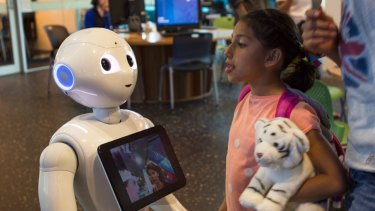 """Researchers at QUT have altered a robot controlled by an AI to become more """"social""""."""