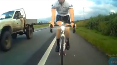 A cyclist captured on camera the moment a bottle is hurled at one of his fellow riders at Cairns.