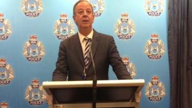 Detective Superintendent Glenn Feeney outlines the charges to reporters.