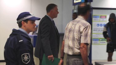 David Standen (right), also known as Peter William Standen, is arrested at Sydney Airport on August 19, 2014.