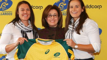Wallaroos stars Sharni Williams (left) and Shannon Parry (right) with Buildcorp's Josephine Sukkar.