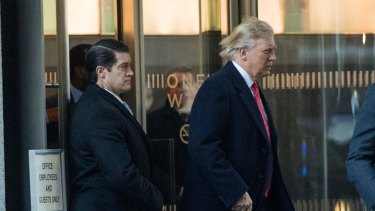 President-elect Donald Trump departs a meeting at the Conde Nast offices on Friday where he reportedly met with Anna Wintour.