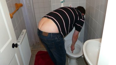 Luke Rafter unblocking his friend's toilet.