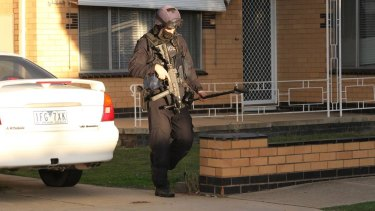 A member of Victoria Police's special operations group at the scene in Wangaratta.