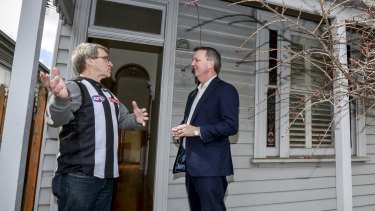 Housing Minister Martin Foley and homelessness program resident Trevor Wulf at a Collingwood house that was acquired for the abandoned East West Link.