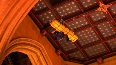 A bell-ringer who had a heart attack is lowered through a trapdoor in the St Mary's Cathedral bell tower.
