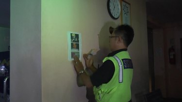 Wanted notices being posted at the Bounty Hotel in Kuta.