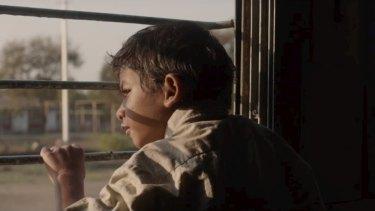 Lost on a train ... Saroo as a boy.