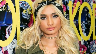 A teenage paparazzo has defended wishing a death threat on US singer Pia Mia when she refused to stop for a picture in Sydney.